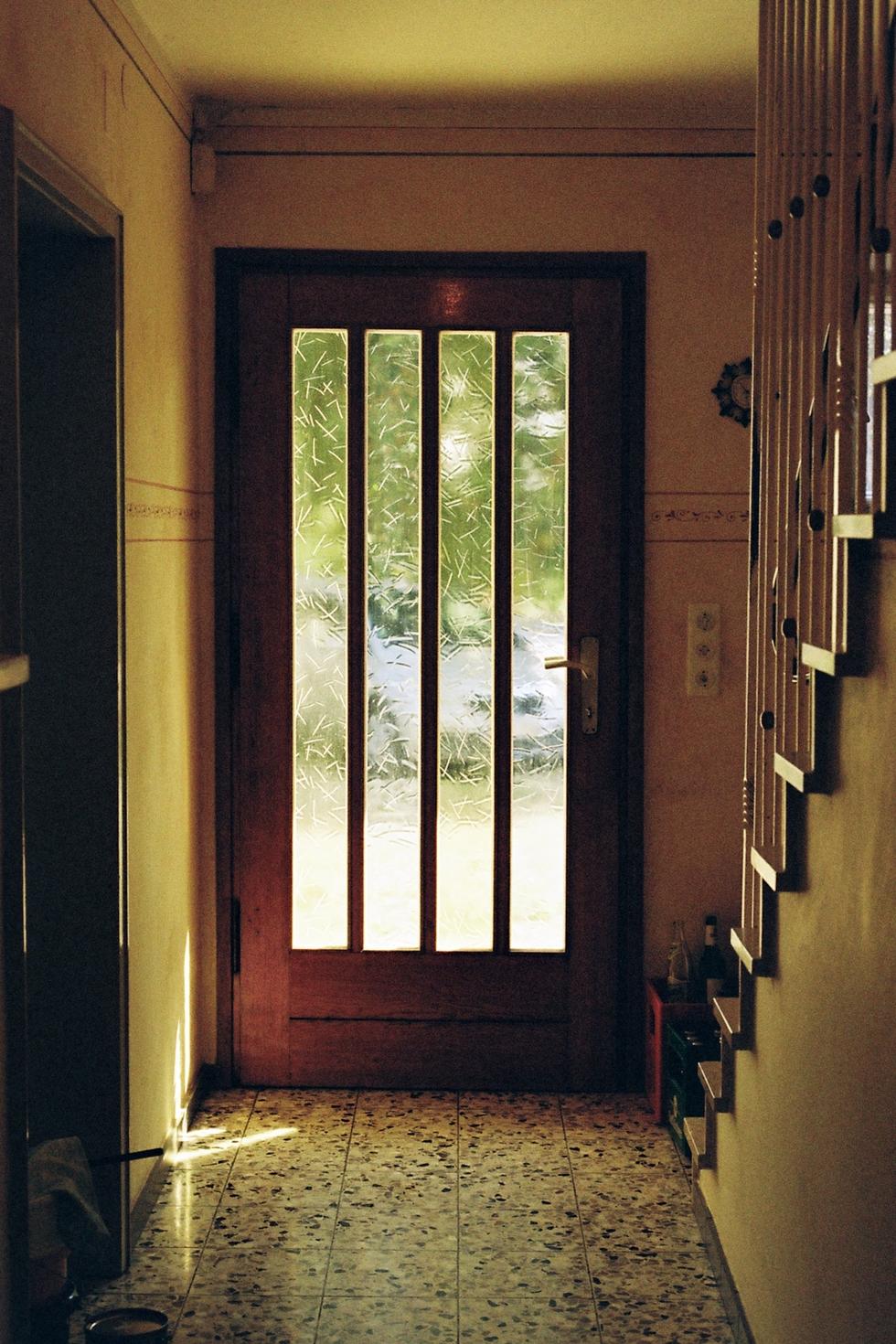 frontdoor with glass yellow light